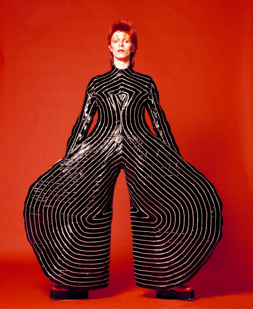 David Bowie & striped bodysuit for Aladdin Sane tour 1973Design by Kansai YamamotoPhotograph by Masayoshi Sukita© Sukita The David Bowie Archive 2012
