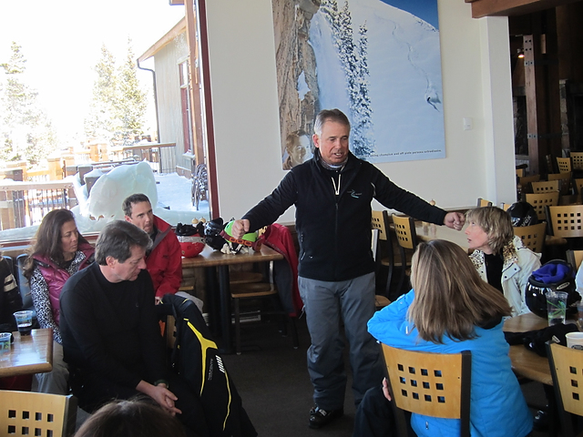 Clendenin enlightening the group before hitting the slopes one morning. Photo by Lynn Goldsmith.