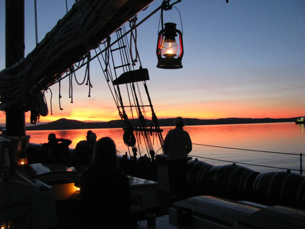 Lantern at sunset. Courtesy Maine Windjammer Association.