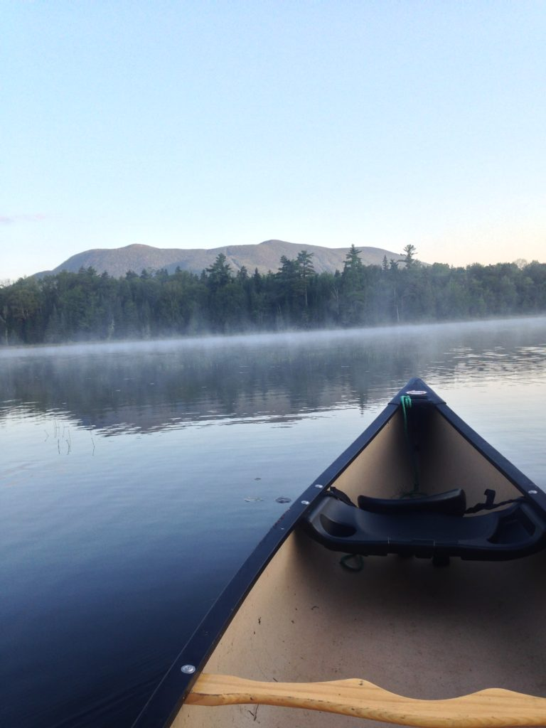 A morning fishing expedition by canoe on AMC's Little Lyford Pond in Maine
