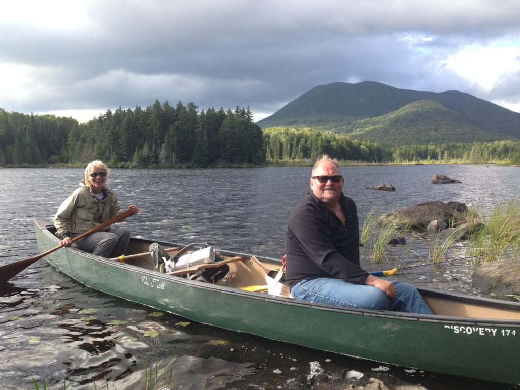 Lani LeCasce and Frank Schaeffer on the shores of Mountain Brook Pond at AMC's Little Lyford Lodge & Camps