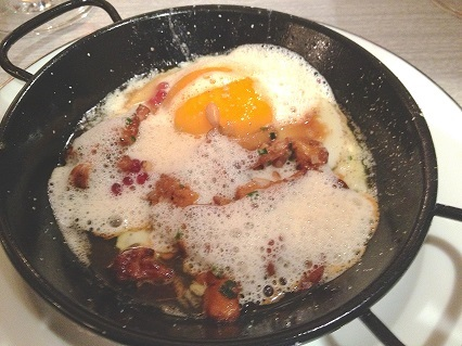 Saute of mushrooms with an egg.