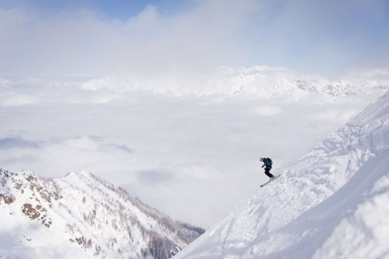 A file picture taken on February 13, 2013, in the Rosa Khutor Extreme Park, some 50 km from Russia's Black Sea resort of Sochi, shows a skier seting off from the peak of Mount Aigba.