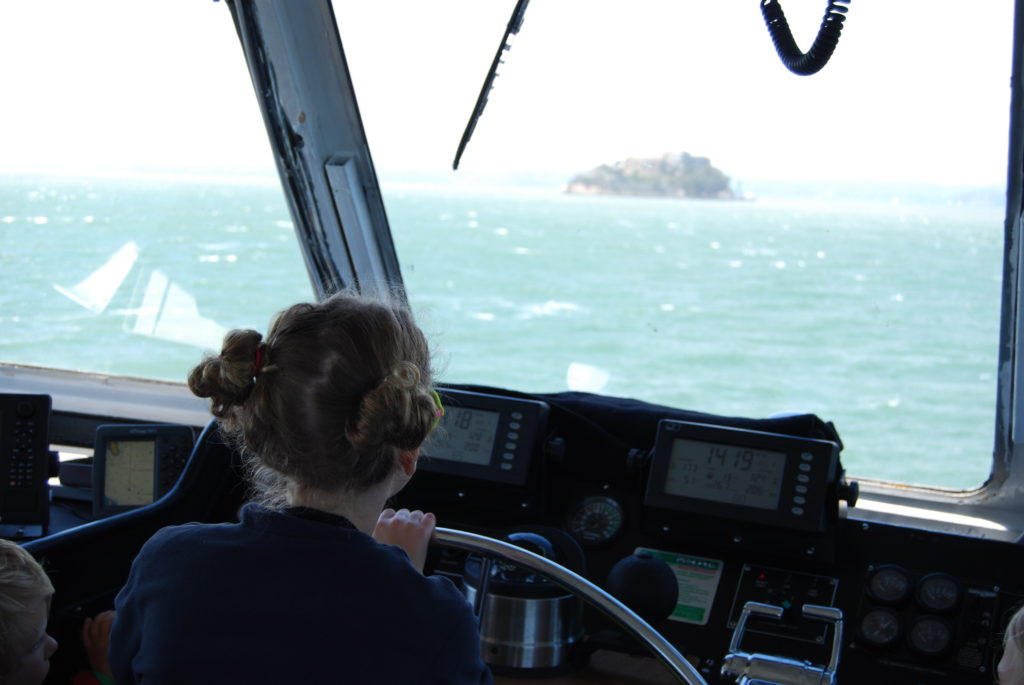 Claire at the helm of the ferry.