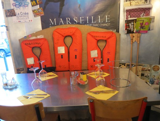 Table with life vests at La Boîte à Sardine, Marseille