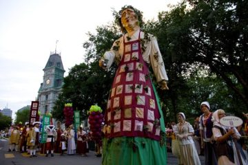 Each August the 17th century comes to life in Quebec City as the New France Festival  opens with a gala evening parade featuring larger than life costumed characters depicting historic figures from the city's early colonial days, Quebec City, Canada.