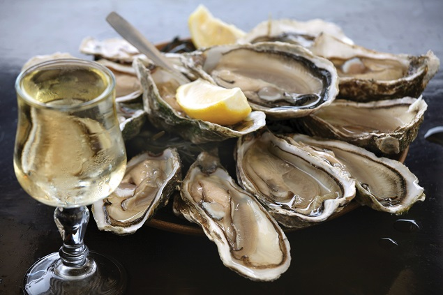 Plates of oysters, Cancale. Photo credit Steven Rothfeld