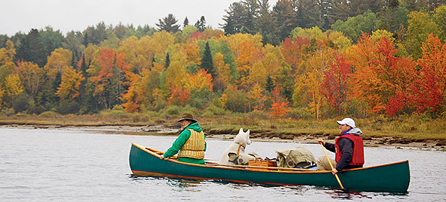 Kevin Slater and Steve Jerrmanok paddling down the West Branch of the Penobscot River in Maine.