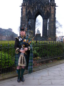 A busker in Highland Dress on Princes Street, Edinburgh. Photo: Monique Burns