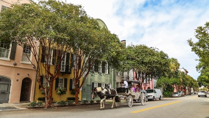 The downtown historic district is one of the great American neighborhoods and exploring it by horse drawn carriage is a popular visitor activity. Photo: Charleston CVB, ExploreCharleston.com