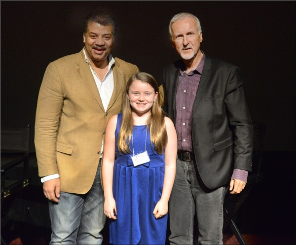 NG Kid Reporter Emma Potter with astrophysicist Neil deGrasse Tyson and Nat Geo Explorer-in-Residence James Cameron at a screening of Deepsea Challenge 3D at the American Museum of Natural History in New York.