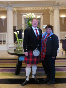 At The Balmoral in Edinburgh, Senior Concierge Andy Fraser, the hotel's Tartan Butler, bids farewell to the author, and to her clans, the Masons and Burnses. Photo Monique Burns.