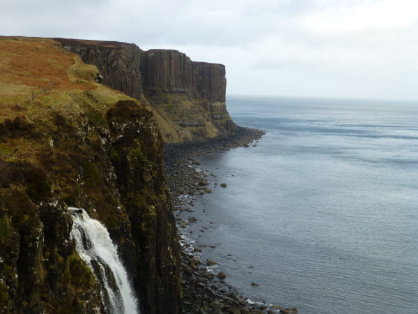 On the Isle of Skye, a waterfall with stony-pleated Kilt Rock in the distance. Photo Monique Burns