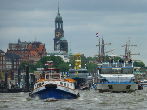 A parade of boats celebrates Hamburg's 825th port anniversary.