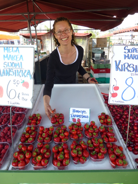 In Helsinki's sunny Market Square, a local vendor sells strawberries, cherries and raspberries. Photo by Monique Burns