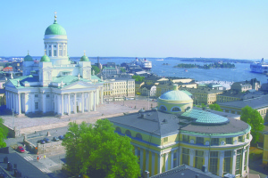Overlooking Helsinki harbor, the verdigris copper dome of Helsinki Cathedral. Photo Visit Finland