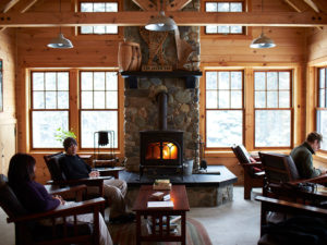 Lounging in the Lodge at AMC's Gorman Chairback Lodge & Cabins, Maine