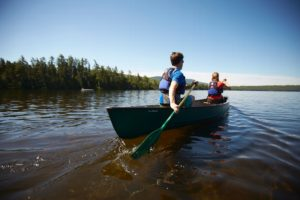 Paddling on Long Pond at AMC's Gorman Chairback Lodge & Cabins, Maine.
