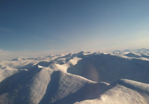 In-flight view of the wilderness around the Arctic Circle.