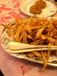 A mountain of hot homemade frites.