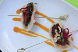 Kelly Liken serves up a Lamb Loukinaka Sausage with Coriander Carrot Sauce