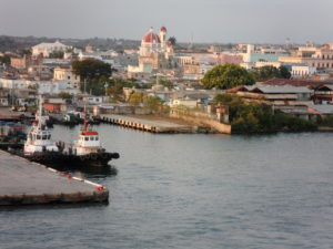 From the port of Cienfuegos, the historic center is easily spotted by church towers and the copula of the Casa de la Cultura.