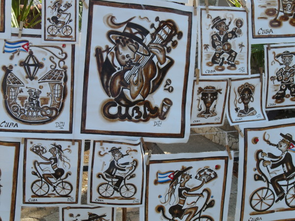 A tourist stall on El Morro hill sells amusing Cuban caricatures.