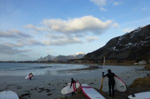 Stand-up paddleboarders with Lofoten Adventure Company scurry to the waters off Ramberg Beach. PHOTO Monique Burns