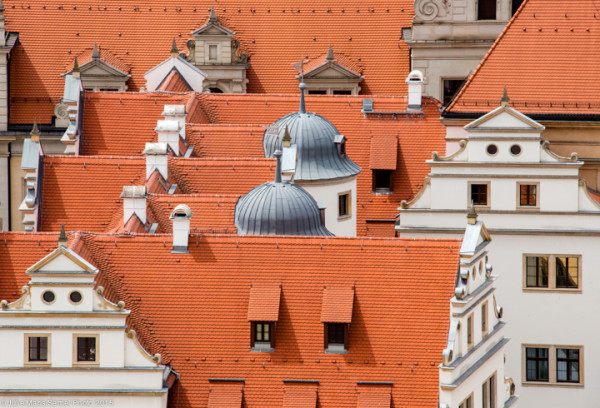 A view of Dresden's Royal Palace museums' mottled red-clay tiles roofs from Frauenkirche's dome