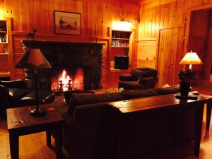 Living room with stone fireplace in Loon cottage.