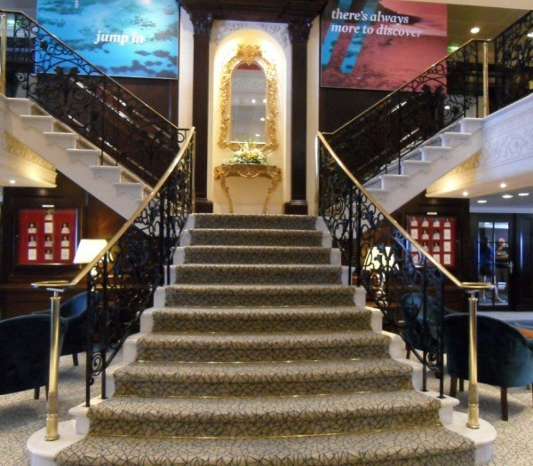 "The grand staircase in Adonia's lobby is an elegant feature easily recognized by fans of former ""R"" ships."