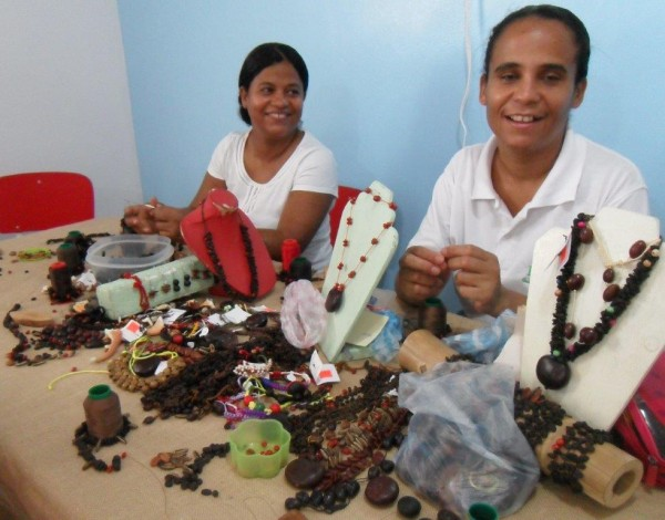 Ladies of RePapel make jewelry from seeds and other natural elements to sell