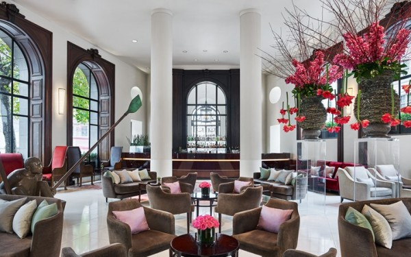 "The Lobby Bar dominated by Andre Wallace's ""Boatman with Oars"" at One Aldwych, London"
