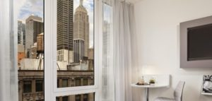Twin bedroom with Empire State Building view.