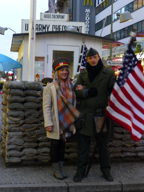 At Checkpoint Charlie, a German in U.S. Army garb poses with a visitor PHOTO Monique Burns