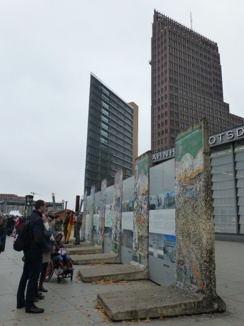 Chunks of the Berlin Wall dwarfed by contemporary skyscrapers in Potsdamer Platz PHOTO Monique Burns