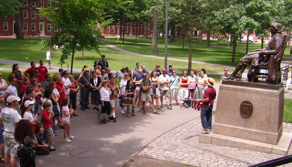 Group Around John Harvard Statue. Courtesy Trademark Tours