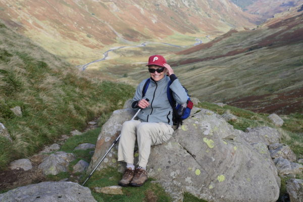 Senior hiker Ellie Smith in Stake Pass with Borrowdale behind her. © Sara Hudston